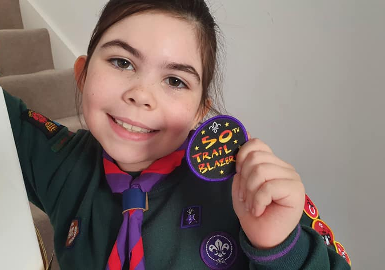 Our winner shows off her design for our 50th year celebration occassional badge